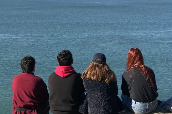 Carlos Pasillas, Cruz Solano, Myself, Alia Ortiz sitting on a cliff in San Francisco