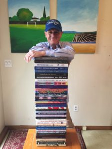 Mr. McGovern with his 40 CB yearbooks (including four from when he was a student)