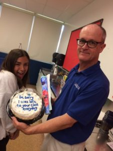 "Olivia Ortiz giving Mr. McGovern a cake saying ""I'm sorry I was late to your class everyday"""