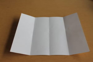 4) Unfold all of the folds and lay it out on a flat surface.