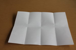 6) Unfold the paper and smooth it out.
