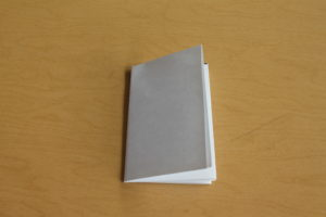 11) Fold the paper over to create a booklet.