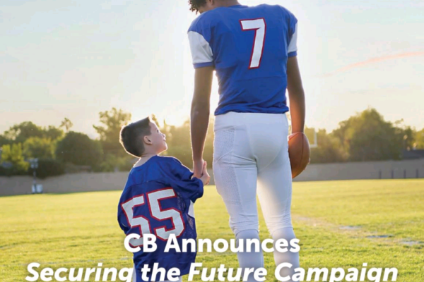 Athlete Tyler Green and a kid promoting the Securing the Future Campaign on the cover of the Fall 2018 edition Connection Magazine