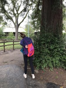Saej and Shep's own personal spy, Michaela, stalks from behind a tree with her inconspicuous umbrella and bag.
