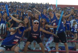 Falcon Force poses in their red and blue at Holy Bowl