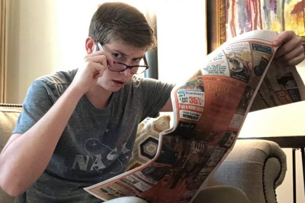 john-reading-the-news-scaled-e1603403438491-1024x900-1